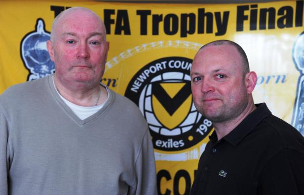 BACK TO LIFE: Newport County fan Gerald Evans collapsed before Saturday's match at Torquay United. His life was saved by a policeman. Gerald is pictured recovering at home with his nephew Mark Avery (right) who was with him at the match Pic: JON BEVAN
