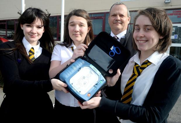 PUPILS' DECISION: Concerned pupils prompted Risca Comprehensive School to buy a life-saving defibrillator machine following a talk by  campaigning mum June Thomas. Pictured with head teacher John Kendall are Elinor Horton, Molly Necrews and Eve Szade
