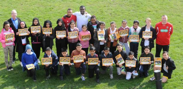 GREAT DAY: Aaron O'connor and Ismail Yakubu, centre, with pupils from Maindee Primary school and Norman Parselle, right. Picture: Chris Tinsley