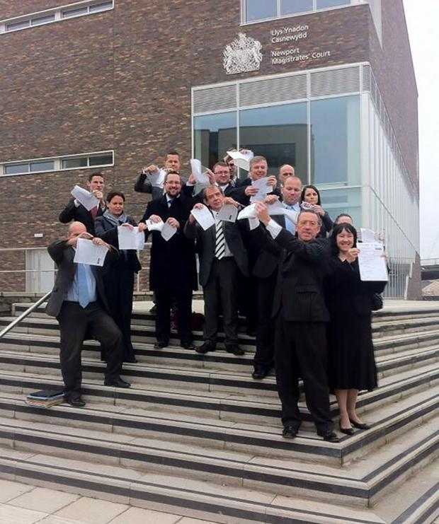 South Wales Argus: PROTEST: Striking solicitors outside Newport Magistrates' Court today ripping up legal application forms