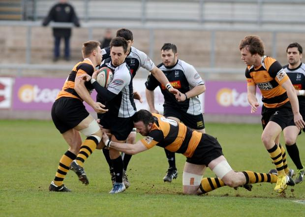 TACKLED: Cross Keys' Ryan Lee is caught by the Newport defence