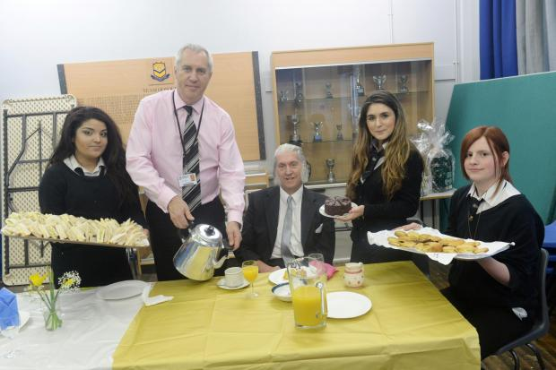 TEA PARTY:  Former Duffryn High pupil Gordon Jones is served tea by head teacher Jonathan Wilson with the help of sixth form students Amina Mitha, Ines Fonseca and Nathan Bird