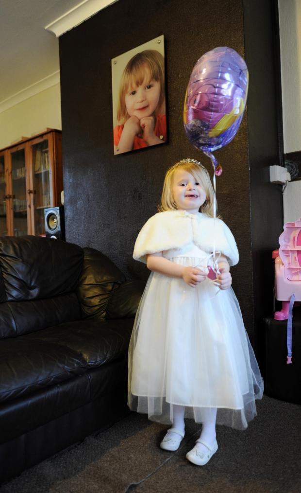 South Wales Argus: Four year old Annalese Gosling has a rare condition called Fibrodysplasia Ossificans Progressiva (FOP), which means her body keeps producing bone, in muscles and soft tissues.  Pictured is Annalese dressed ready for a charity event at the Celtic Manor Res