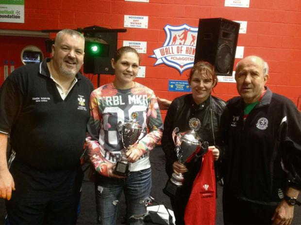 TOP TEAM: Ashley Brace, second from right, with her Welsh vest and Elite Championships trophy alongside Torfaen Warriors coach Simon Weaver, fellow Torfaen fighter Becky Price and former national coach Tony Williams