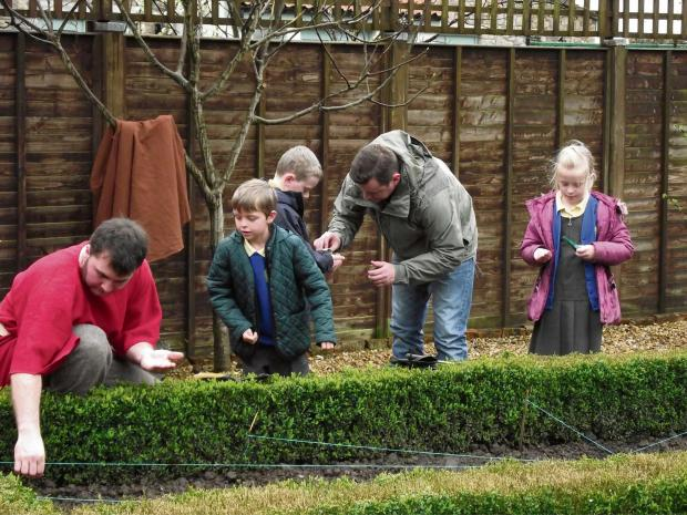 REMEMBERING: Pupils help sow poppy seeds at the museum