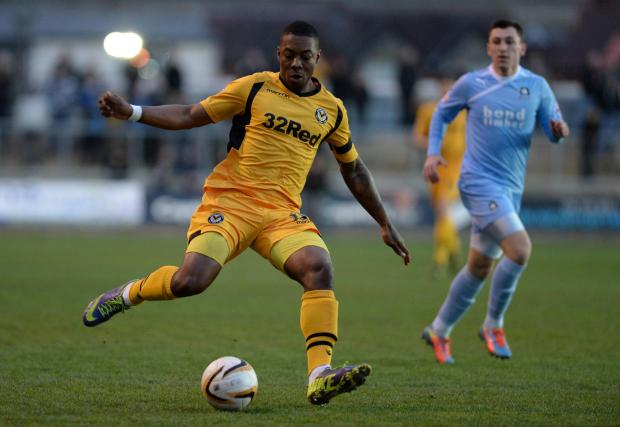 ATTACKING INTENT: Newport County's Ryan Jackson takes on the Plymouth defence