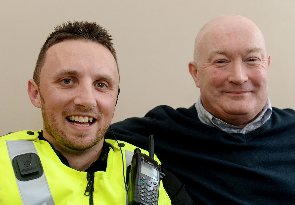 LIFESAVER: Gwent Police officer Matthew Screen with Newport County fan Gerald Evans