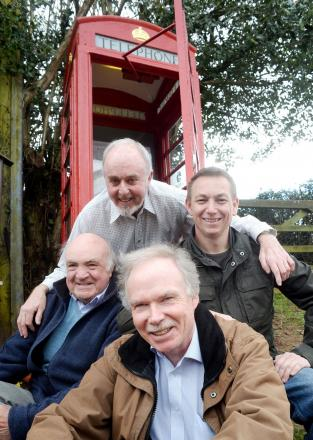 PHONE A FRIEND: From top, clockwise, Pete Walters, Rob Nelson, Nick Brooks and John Lewis refurbished the phone box in Pen-y-Fan near Trellech