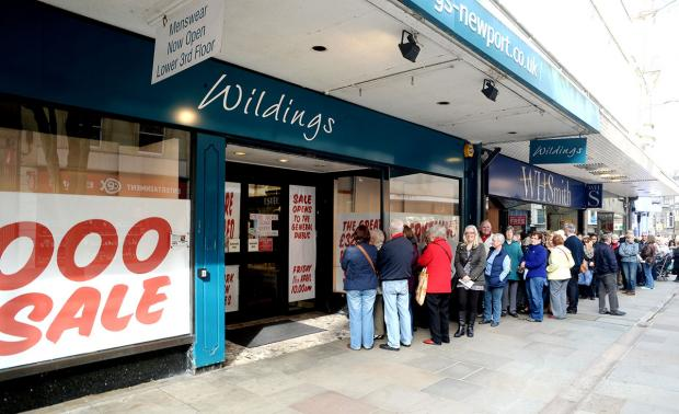 QUEUES: Some of the 3,000 shoppers who came to Newport's Wildings store for their sale today