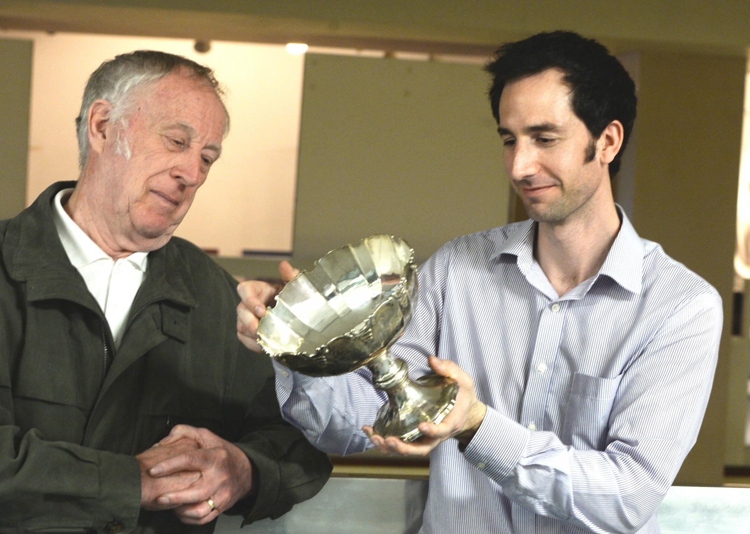 Derek Everett, (lt), who brought in a presentation cup gets Newport Museum curator Oliver Blackmoore to cast his eye over as part of historical objects being looked over to see if they could be taken by the museum (5285830