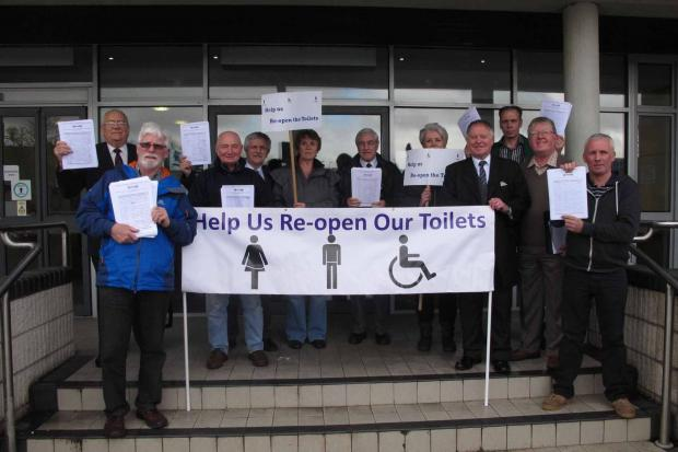 FIGHTING BACK: Ebbw Vale councillors and traders with the petition to reopen the Blaenau Gwent toilets