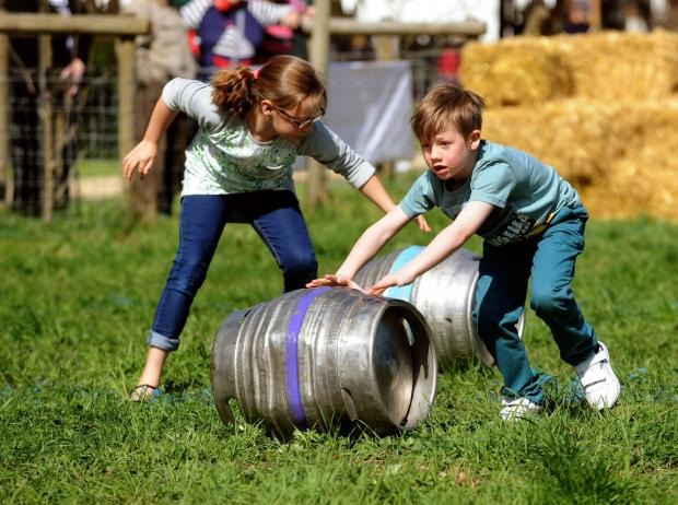 South Wales Argus: Gabriel Jones 8 from Newbridge wins the barrel rolling race at Llanyrafon Manor country fair. (5380743)