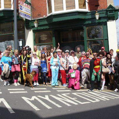FUND RAISERS: Walkers in fancy dress raising money in memory of Steven Lewis, who died in 2011 after being diagnosed with stomach cancer