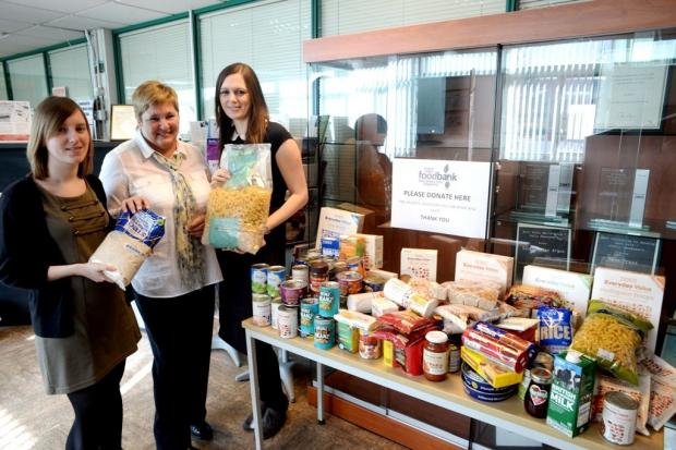Argus writers Hayley Mills, (lt) and Ruth Mansfield are seen officially handing over the food to Jen Taylor, (centre), of the Eastern Valley Foodbank, which was generously donated by staff at the company (4325639)