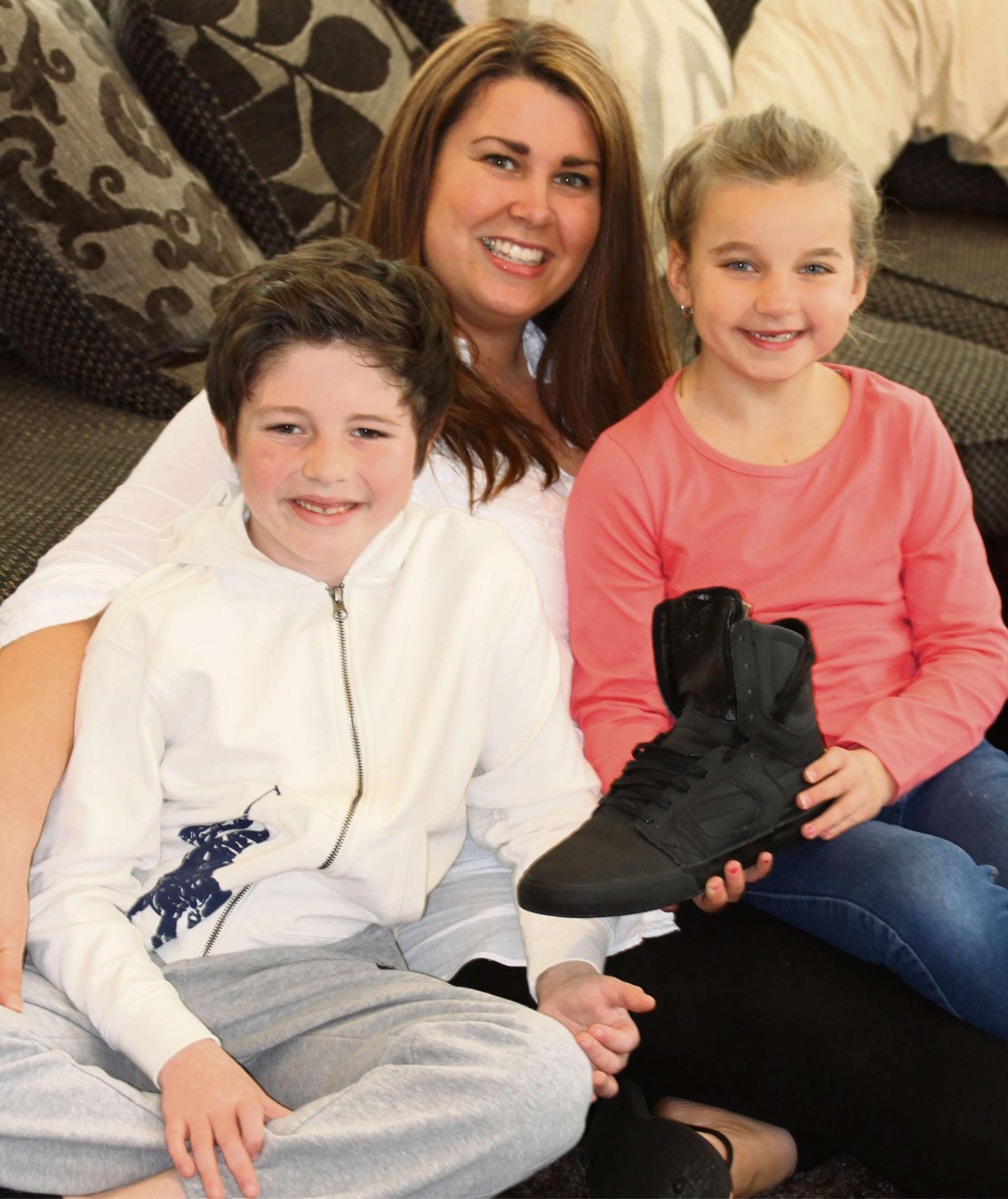Shoe: Khloe Waite with children Ralphie and Beau Waite with Bieber's shoe