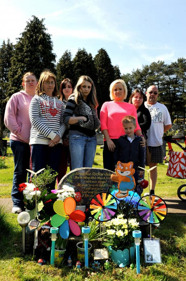 South Wales Argus: Danielle Richardson and Emma Quinn (centre) with supporters at Panteg cemetery where the council have a policy against decorations on graves