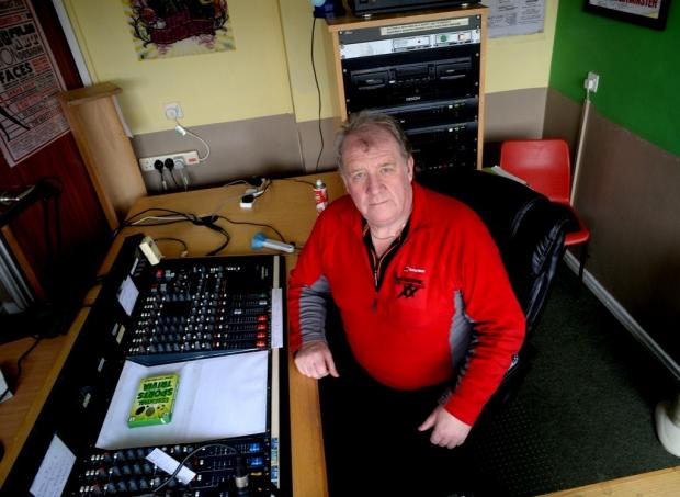 Nevill Hall Sound Radio presenter Alan Leach, (ok), at the desk where valuable equipment has been stolen by thieves at Abergavenny (3553904)