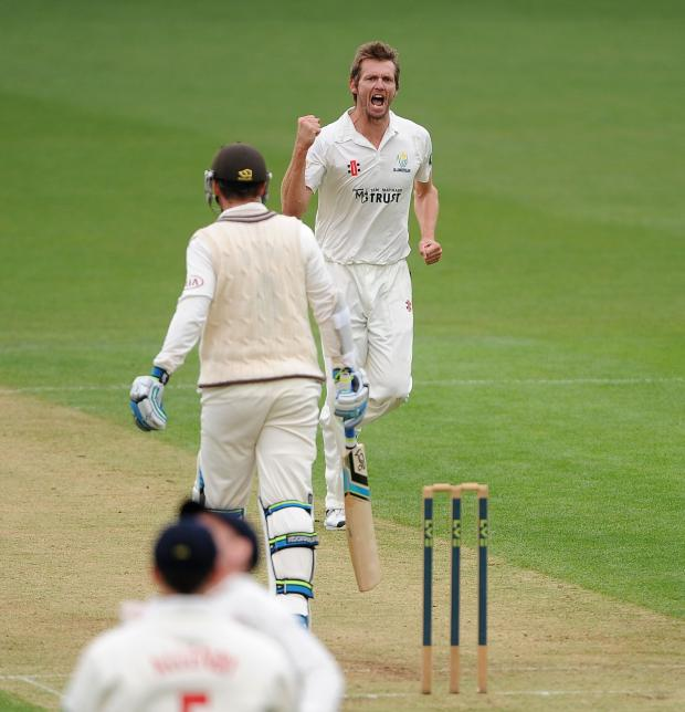 South Wales Argus: Glamorgan's Michael Hogan celebrates after taking the wicket of Surrey's Steven Davies during the LV=County Championship, Division Two match at The Kia Oval, London. PRESS ASSOCIATION Photo. Picture date: Sunday April 6, 2014. See PA story CRICKET