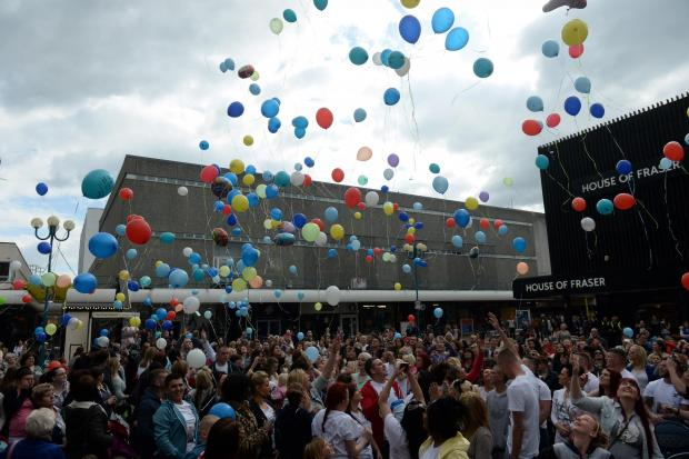 South Wales Argus: Balloons with special messages written on them are released from Gwent Square in Cwmbran in memory of Shae Brynley Button, to raise money for Meningitis Now, (5543474)