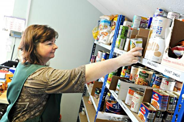 UNDER ATTACK:  A foodbank volunteer at work