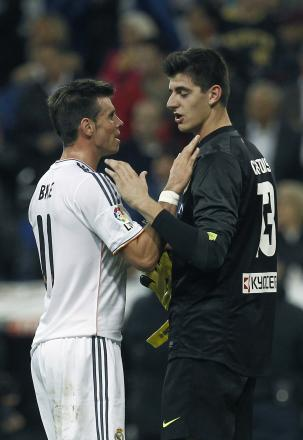 UNFAIR: Thibaut Courtois, seen here with Wales' Gareth Bale, will miss the biggest games of his career