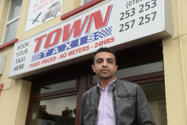 South Wales Argus: Nav Iqbal, who has taken over Town Taxis in Newport at the age of 24. Pictured is Nav Iqbal outside Town Taxis in Newport. (5576059)