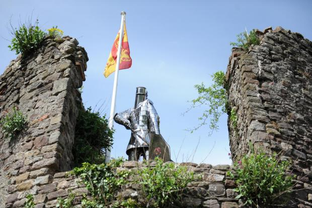 The flag of Owain Glyndwr raised at the Castle Tower for the Caerleon Festival