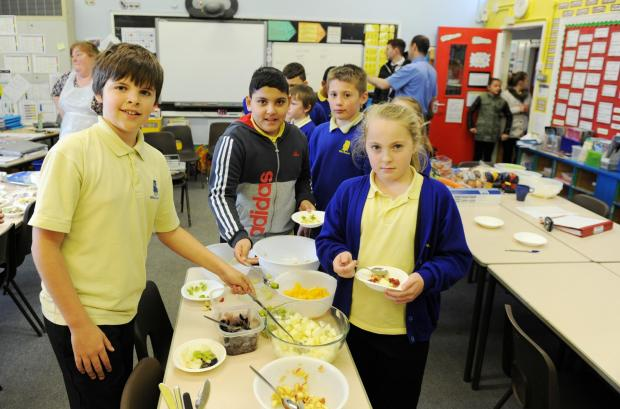 South Wales Argus: School of the Week features Milton Junior School in Newport.  Pictured left is Jayden Featherstone and Libby Thomas plating up fruit salad bowls for lunch, which is encouraged at the school. (5205244)