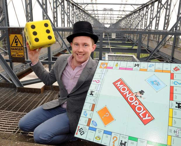 WELSD DECISION: Monopoly Development Director Dan Taylor playing the game on top of the Transporter Bridge in Newport