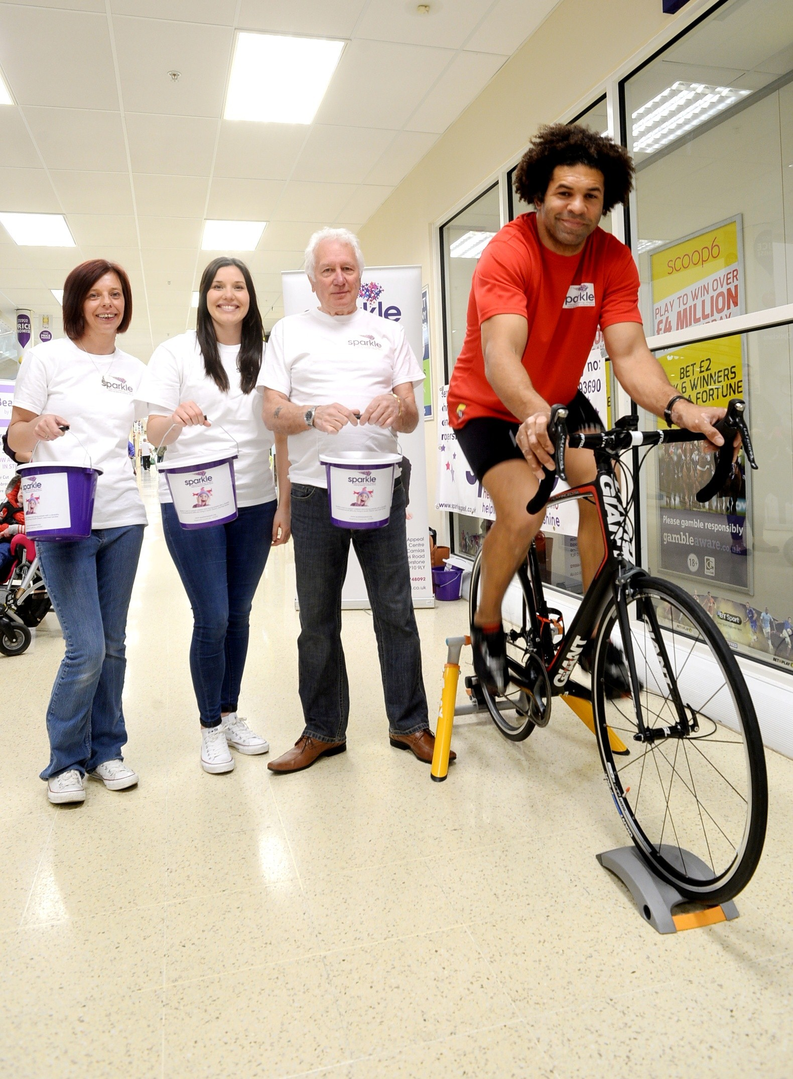 Ex-Dragon Charvis cycles100 miles for kids' centre