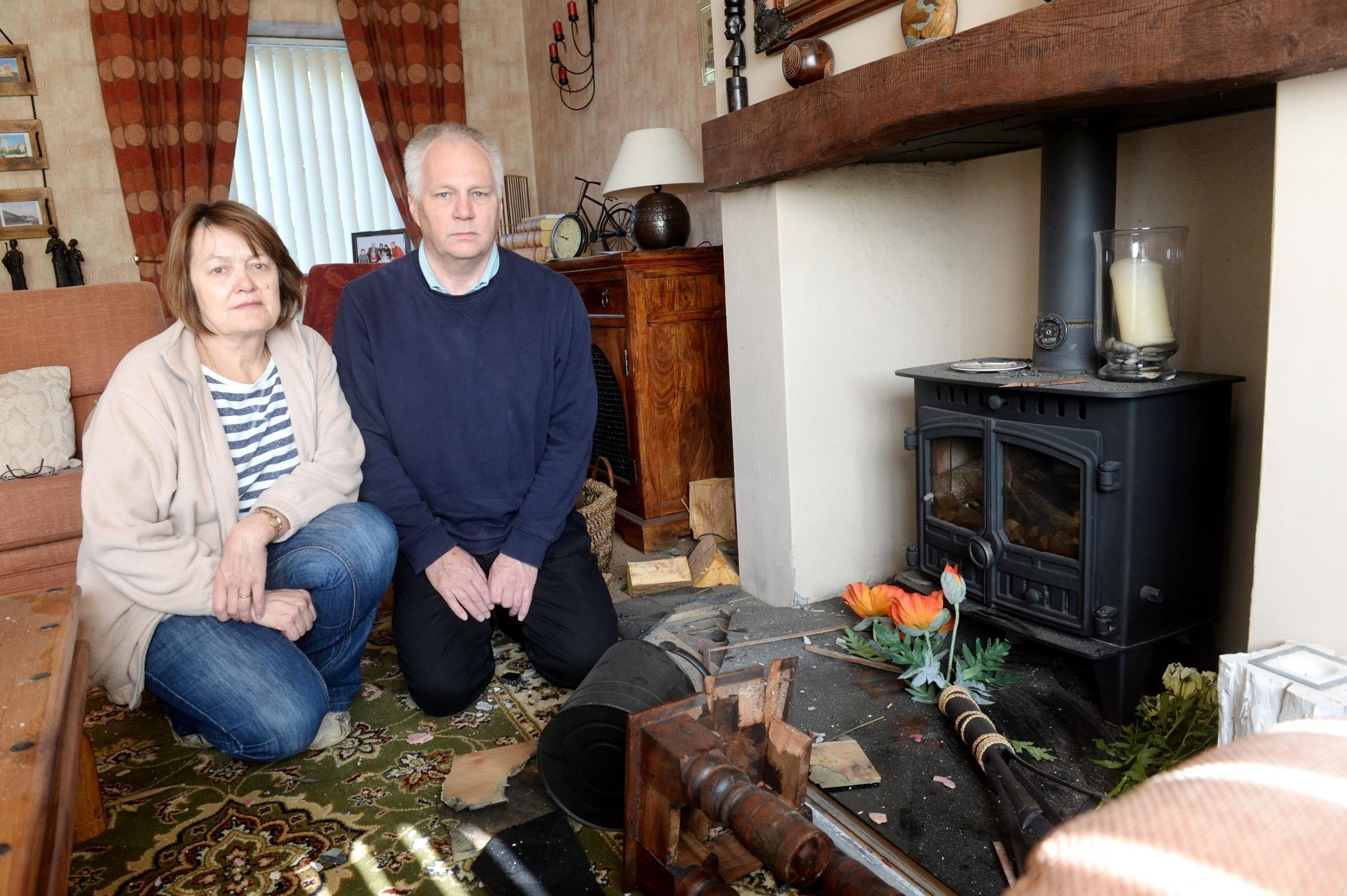 Home of Adrian and Cheyrl Garnham damaged by a lightning strike that hit the chimney of their property in Newbridge. Pictured are Adrian and Cheryl in the living room with the damage caused