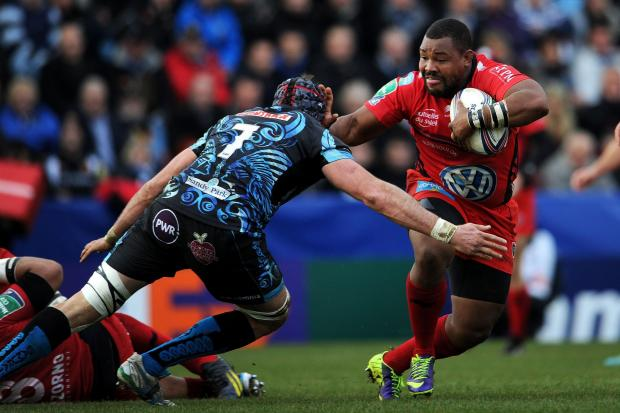Toulon's Stefon Armitage is tackled by Exeter's Ben White during the Heineken Cup match at Sandy Park, Exeter. PRESS ASSOCIATION Photo. Picture date: Saturday December 7, 2013. See PA story RUGBYU Exeter. Photo credit should read: Tim Ireland/PA W