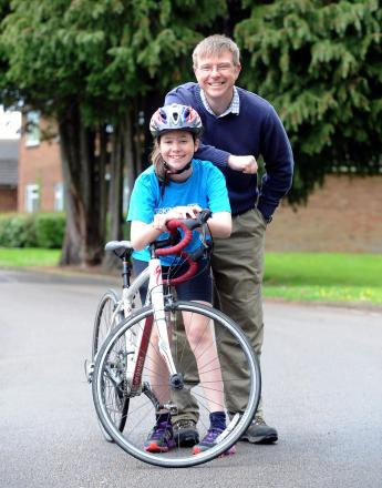 CHALLENGE: Teenager Jess Taylor pictured with her Dad, left, and above on her bike ride. Inset, the inspiration for the challenge, grandmnother Sandra Wanless