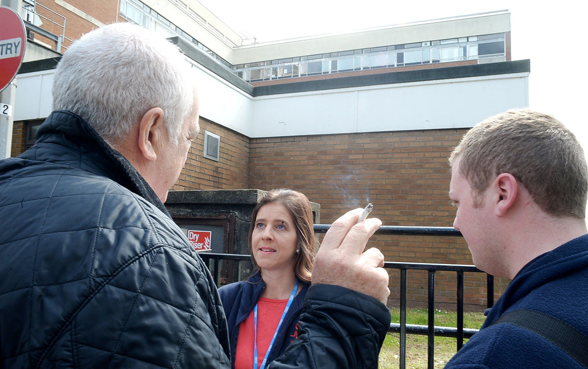SMOKE FREE: Lisa Rowley engages in conversation with a smoker outside Royal Gwent Hospital