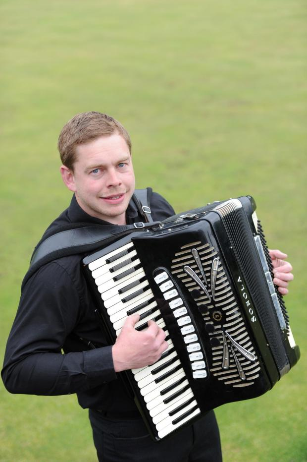 South Wales Argus: Daniel Bailey, 26 from Cwmbran is the musical director of the Gwent Accordion Club.  Pictured is Daniel with his Accordion in his local park. (5769682)