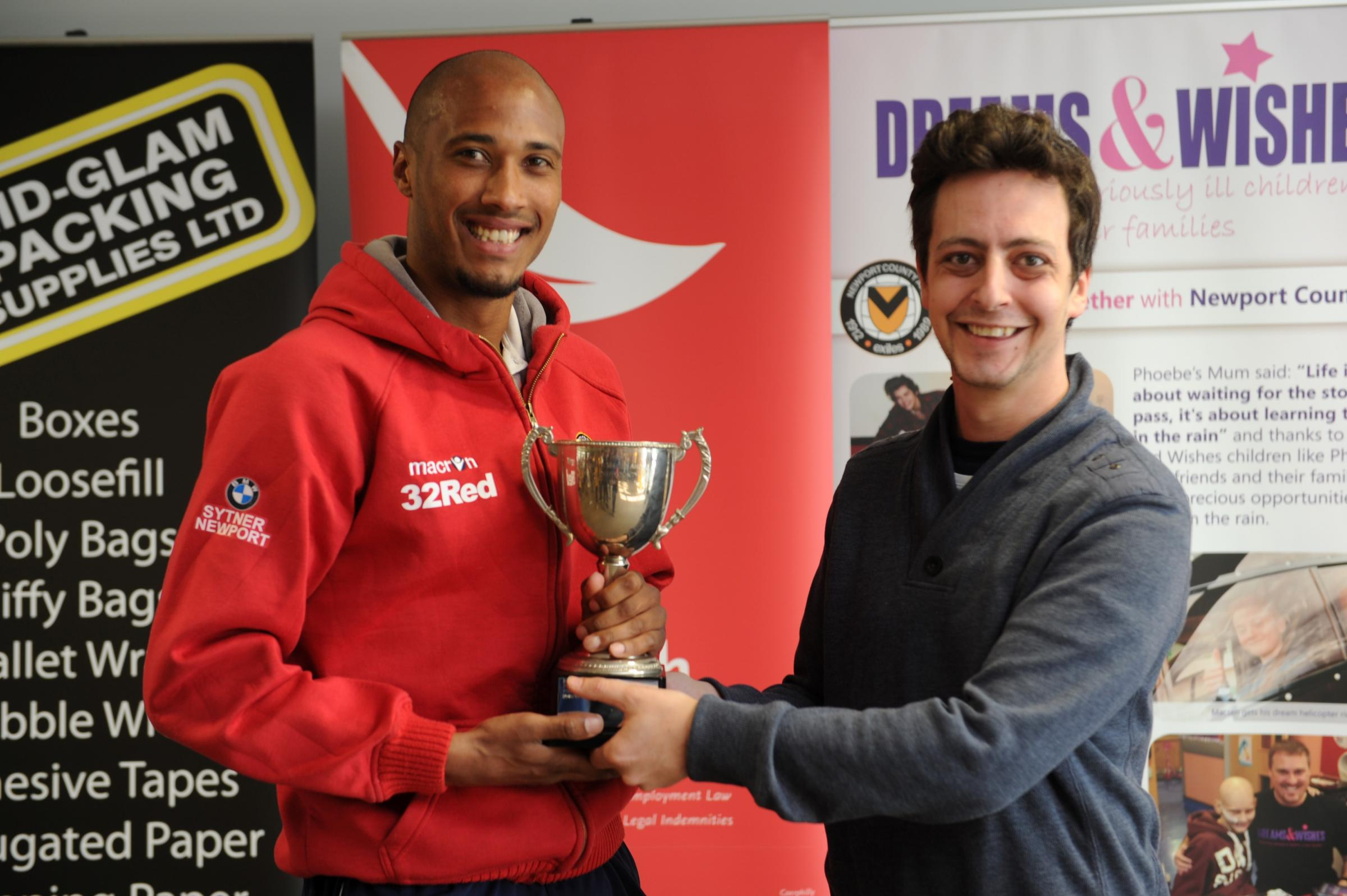 FANS' FAVOURITE: Chris Zebroski receives the Argus player of the year trophy from Argus football writer Michael Pearlman
