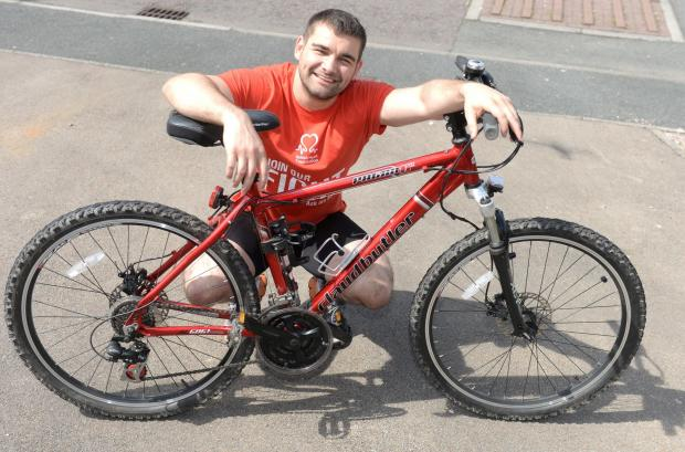 South Wales Argus: Robert Taylor will cycle the Great Wall of China later this year raising money for the British Heart Foundation. Pictured is Robert at home in Newport.   (5919009)