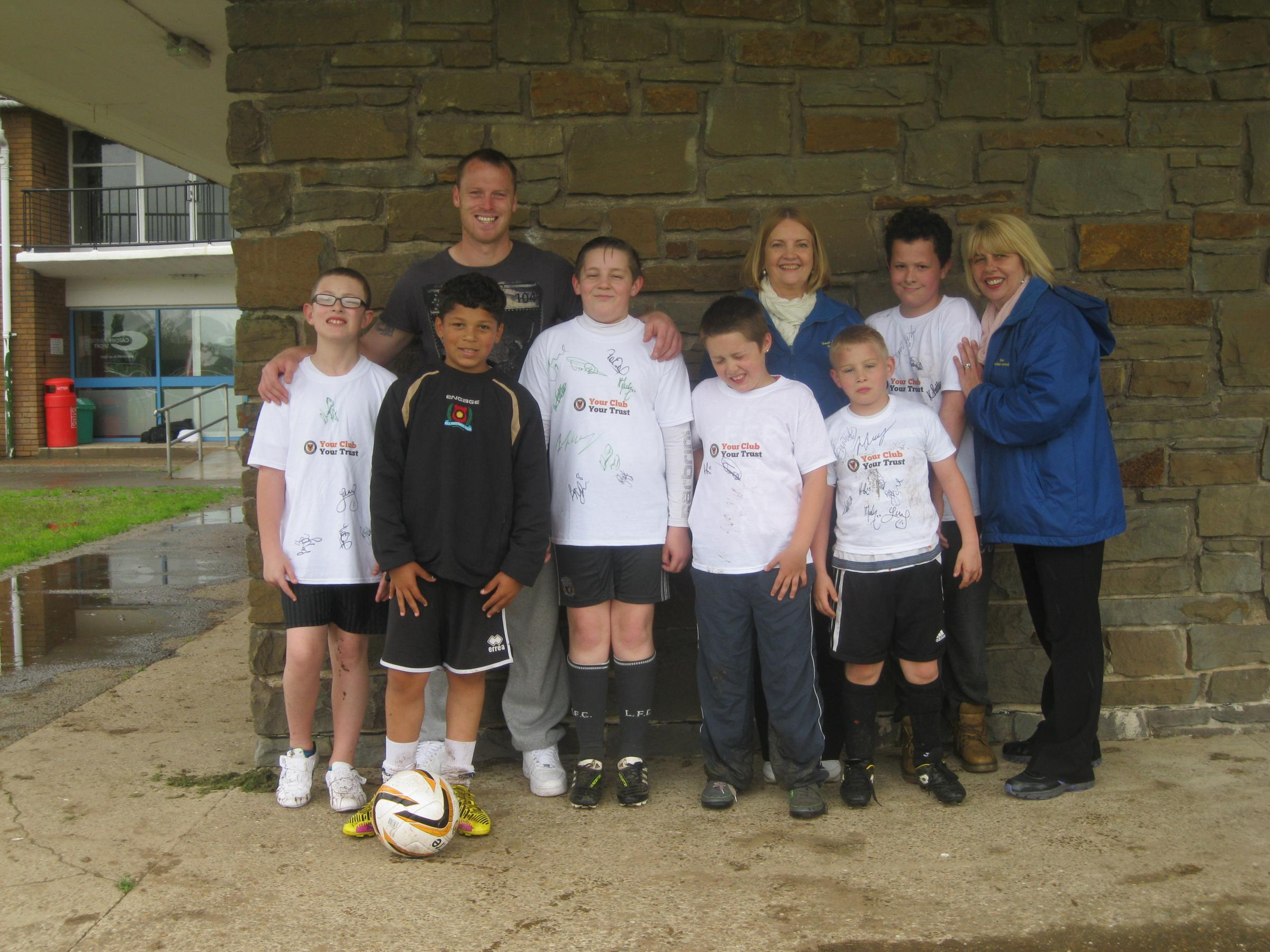GREAT DAY: Gaer Junior School learning support class and teachers with County captain Mike Flynn