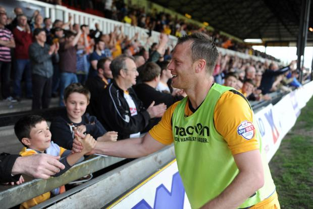 FANS' FAVOURITE: MIke Flynn with County supporters after Saturday's win over Rochdale.  Picture: Mark Lewis