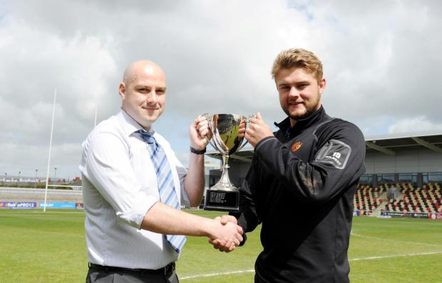 South Wales Argus: Argus Reporter Chris Kirwan hands over the Argus Dragon of the Year trophy to Lewis Evans. (6080880)
