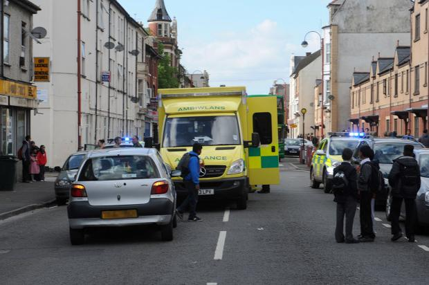 SCENE: Emergency services on on Commercial Road in Newport this afternoon