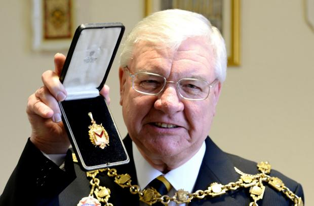 A commemorative gold medal handed back to the Mayor's parlour by the family of Charles Perry Simmonds who served as Mayor 1912/13.Current Newport Mayor Cliff Suller with gold medal (4442041)