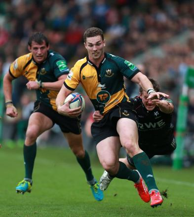 Northampton Saints George North is tackled by Ospreys Jeff Hassler during the Heineken Cup, Pool One match at Franklins Gardens, Northampton. PRESS ASSOCIATION Photo. Picture date: Sunday October 20, 2013. See