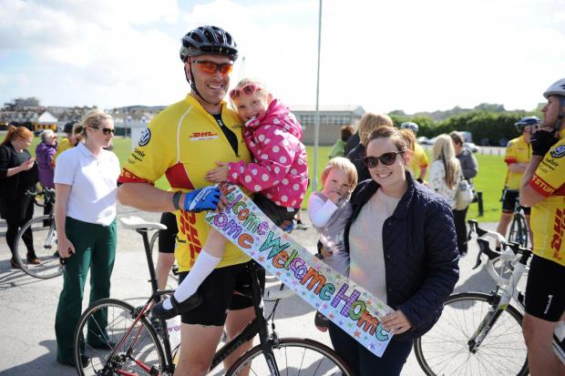 South Wales Argus: FUNDRAISER: Gareth Bailey holding daughter Mollie, six, and with his wife Leanne and daughter Gracie, 18 months