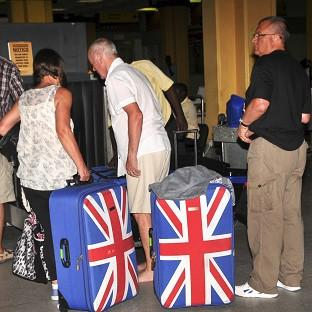 British tourists queue to prepare to leave the international airport in Mombasa, Kenya. (AP)