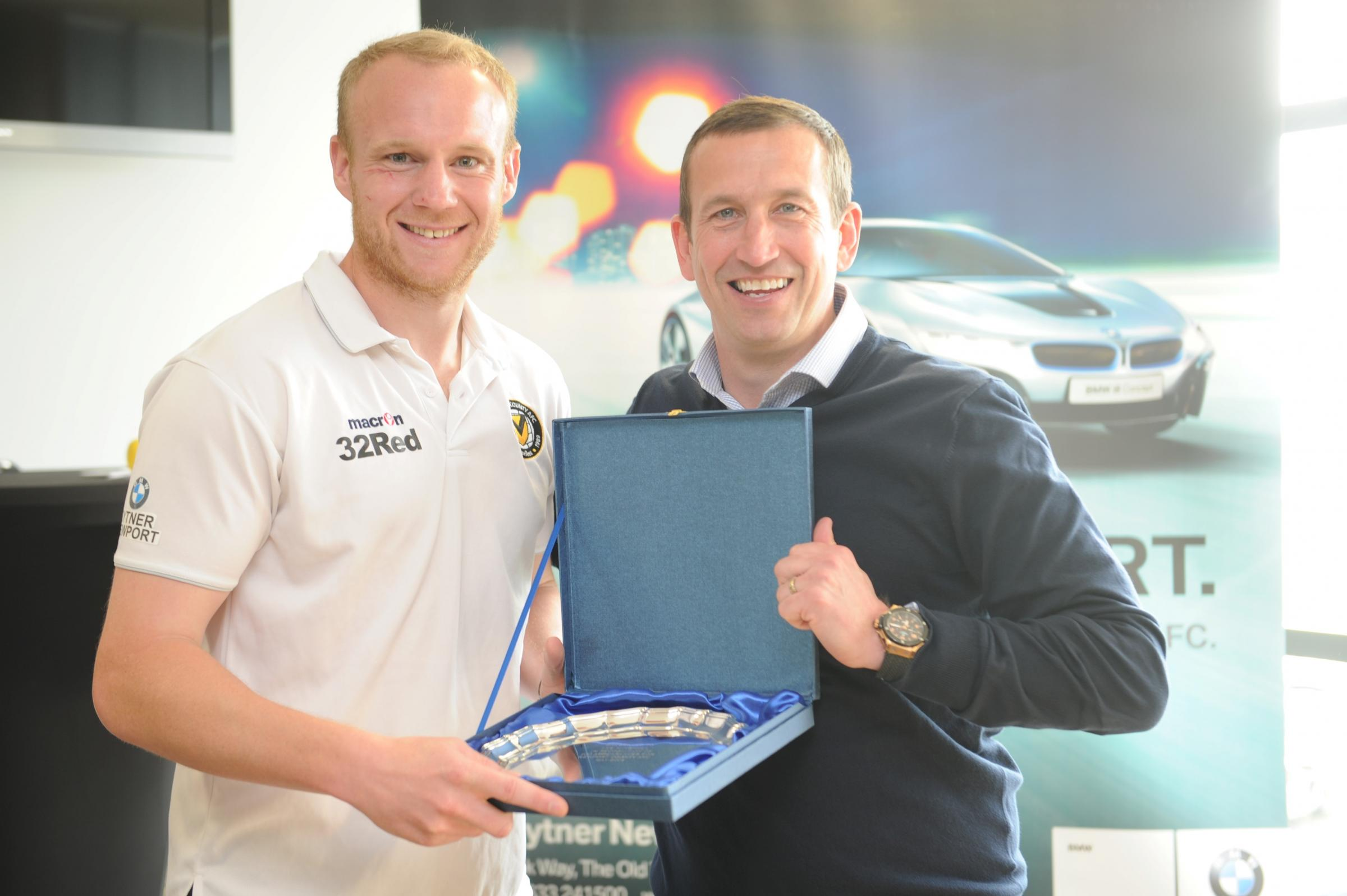 STALWART: Lee Minshull is given a memento to mark is 100 appearances for Newport County by Justin Edinburgh