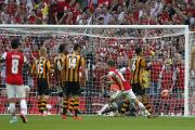 Arsenal's Aaron Ramsey scores his side's third goal during the FA Cup Final at Wembley Stadium, London. PRESS ASSOCIATION Photo. Picture date: Saturday May 17, 2014. See PA Story SOCCER FA Cup. Photo credit should read: Peter Byrne/PA Wire. RESTRICTIONS: