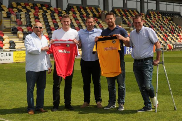 WELCOME: New signings Yan Klukowski and Darren Jones with chairman Les Scadding, manager Justin Edinburgh and director Howard Greenhaf