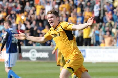 RETURN: Kevin Feely celebrates after scoring the winner against Rochdale on May 3