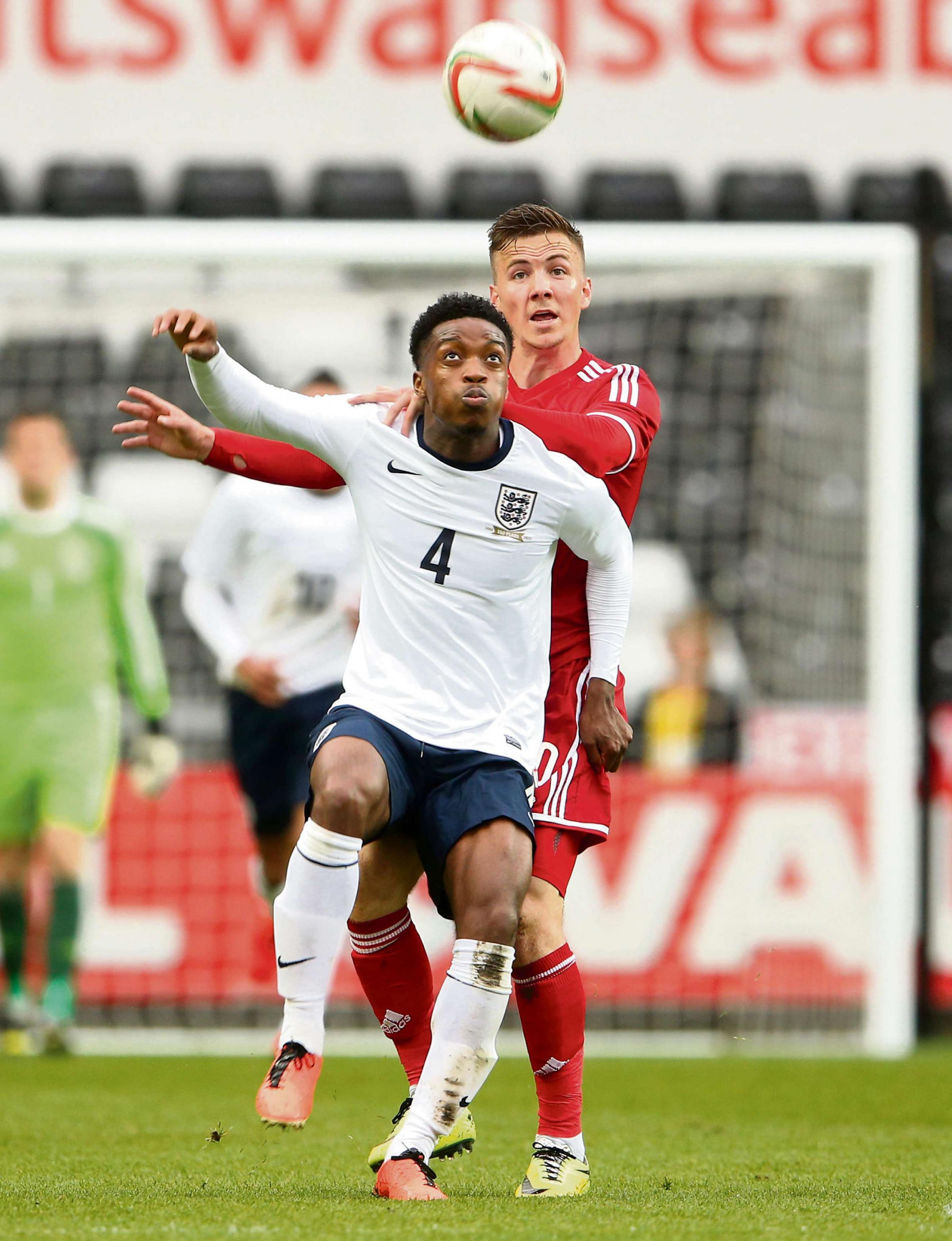 NATIONAL SERVICE: Newport's Lee Evans, right, tussles with Chelsea's Nat Chalobah during this week's Wales v England under-21 qualifier